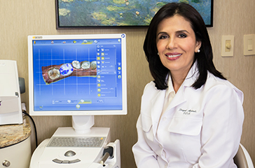 Dr. Alidadi with CEREC planning machine